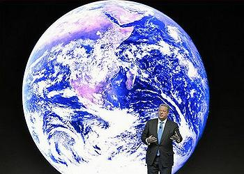Vice President Al Gore, standing in front of Blue Marble